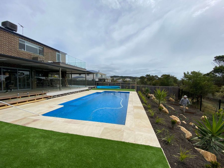 Artificial turf, rock work, plants