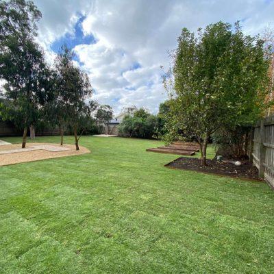 turf lawn corten edging pebbles